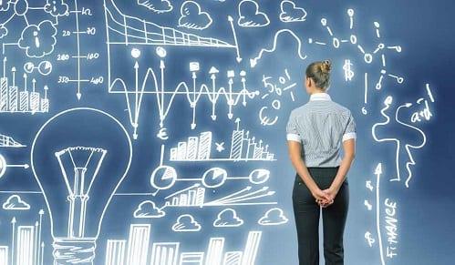 Mulher e várias ilustrações de gráficos simbolizando negócios