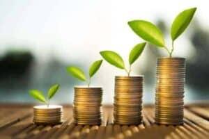 Foto de pilhas de moedas crescentes simbolizando o tema prosperidade