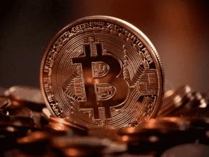 moeda, representando como ganhar dinheiro com bitcoin