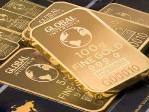 Imagem de uma barra de ouro, simbolizando o conteúdo que ensina como investir em ouro
