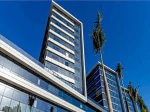Fachada de prédios representando reserva de ações da Melnick