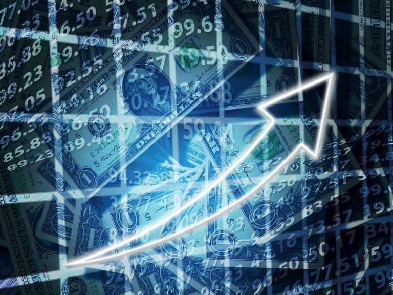 montagem de gráficos e cédulas dólar representando investimento estrangeiro na bolsa